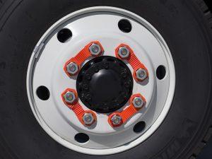 Orange Truck Wheel Nut Safety Indicator